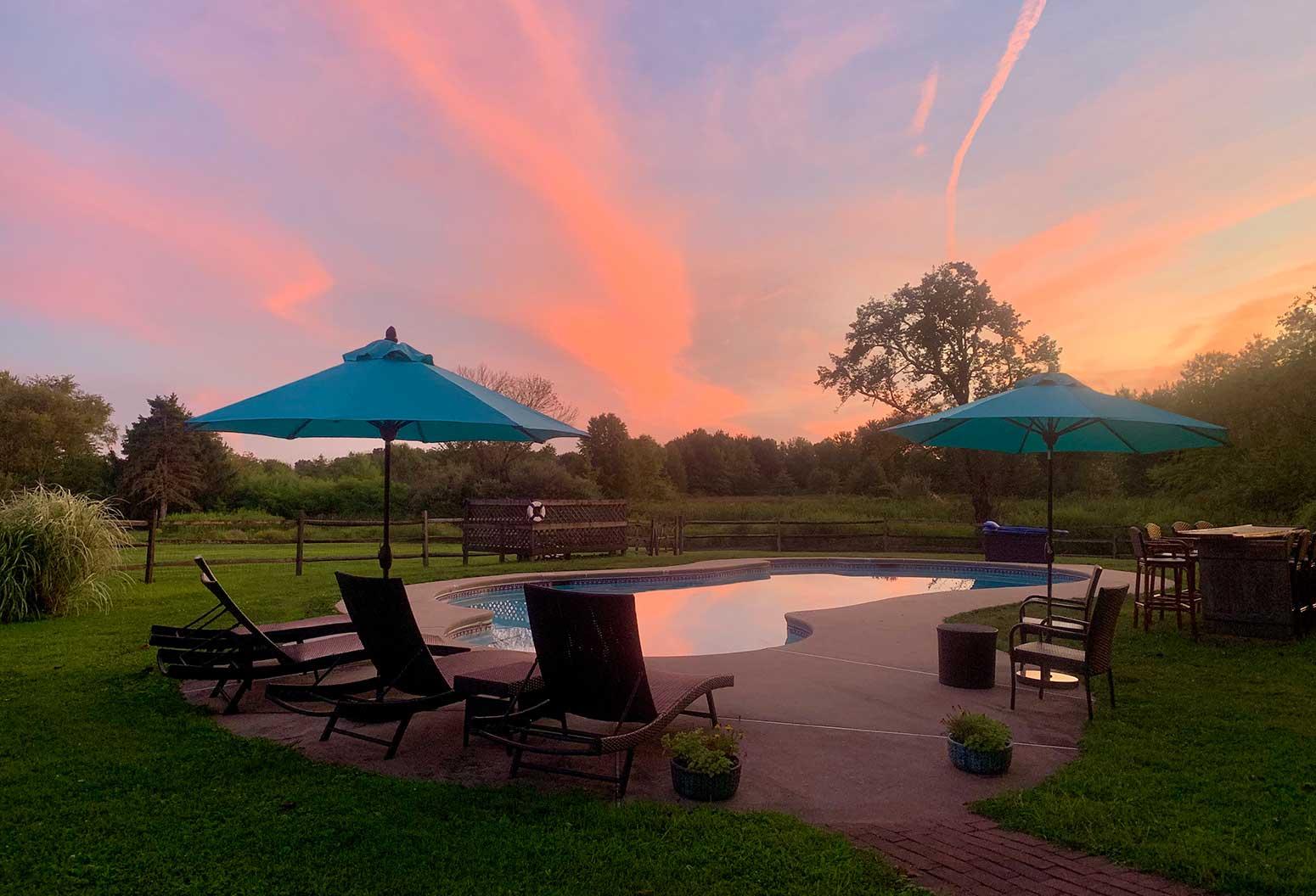 The pool with tiki bar at sunset