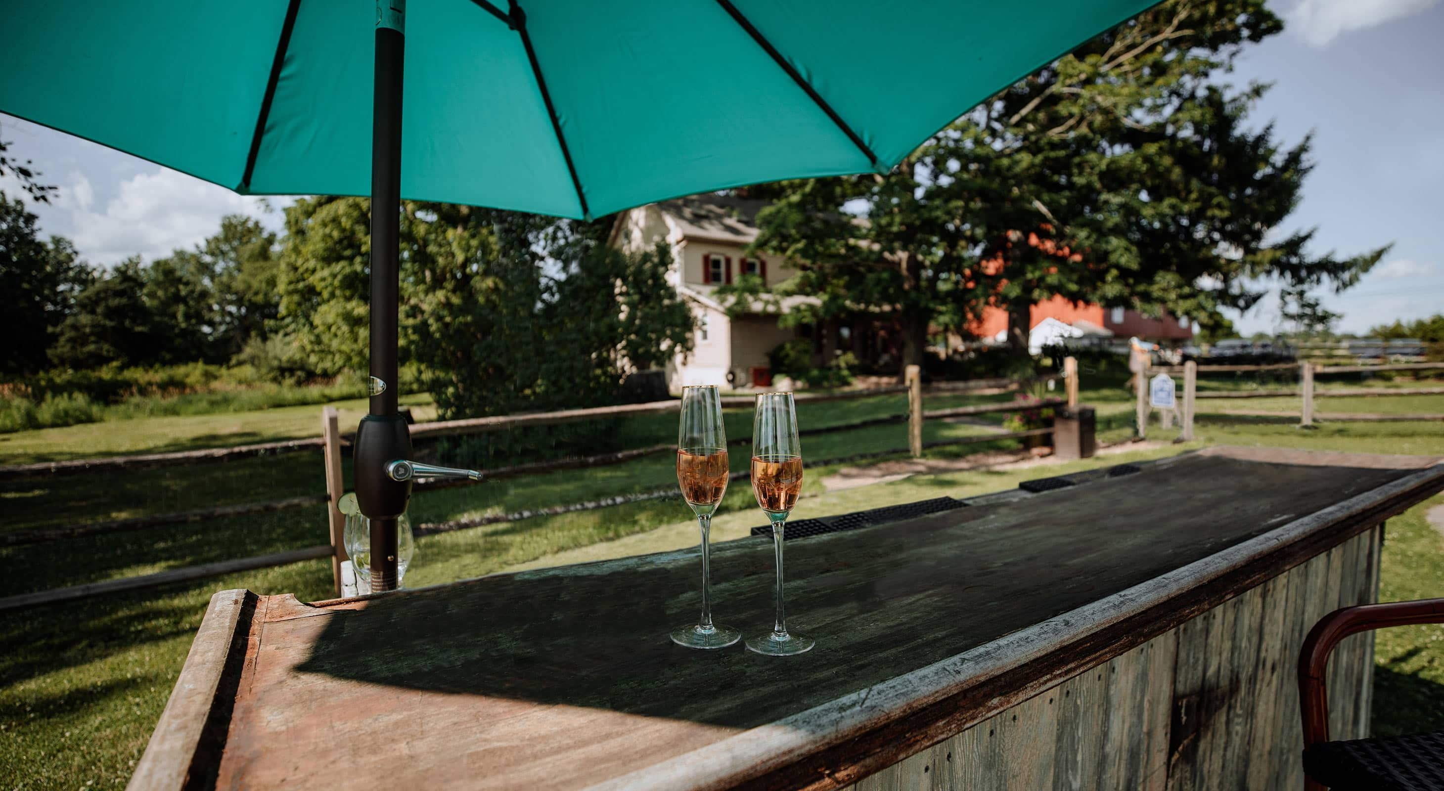 Outdoor Tiki Bar with Two Glasses of Champagne